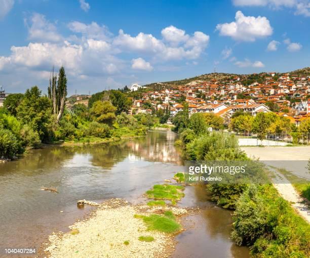 the banks of vardar river in the city of veles, republic of macedonia - macedonië land stockfoto's en -beelden