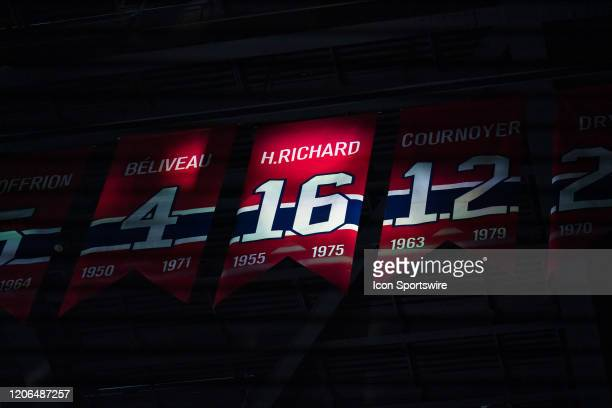 The banner of Henri Richard is lighten during a moment of silence during the first period of the NHL game between the Nashville Predators and the...