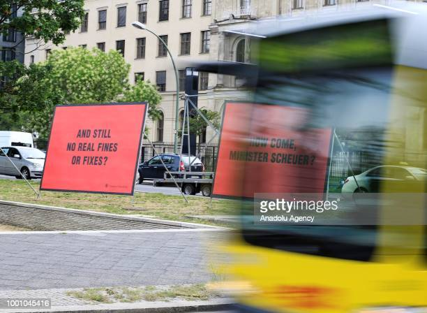The banner reading 'and still no real fines or fixes' that was placed by a part of German Environmental Action members in front of the Ministry of...