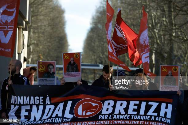 The banner reads 'Tribute to Kendal Breizh revolutionary Breton killed by Turkish Army in Afrin' Kurds demonstrate to pay tribute to French fighter...