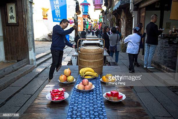 The banquet at the street in Wuzhen To celebrate important festivals as a tradition local people hold open banquet along the street Located in the...