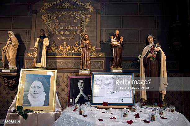 The baptismal certificate of French singer Edith Piaf is displayed during a ceremony to commemorate 50 years since her death on October 10 2013 at...