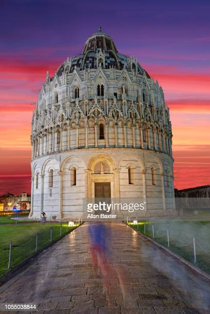 The Baptistry in Pisa against red sky's of Pisa at sunset