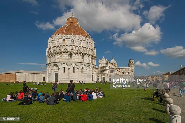 The Baptistry, the Duomo, and the leaning tower of Pisa on the Field of Miracles in Italy.