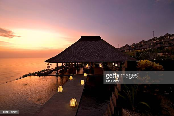 The bar and infinity pool at the Bulgari hotel on the Bukit peninsula of southern Bali situated on the cliffs overlooking the Indian ocean