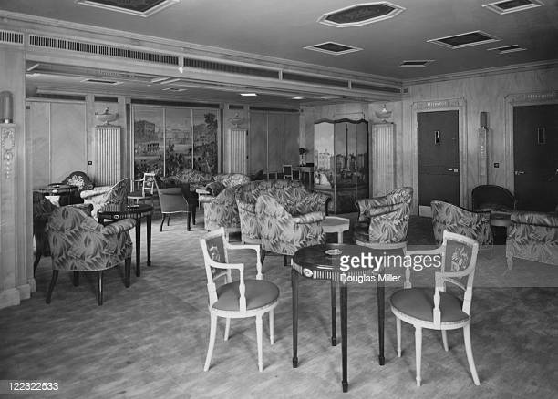 The Bar Lounge and smoke room at new luxury hotel The Dorchester decorated with light walls and red upholstery Park Lane London 20th April 1931