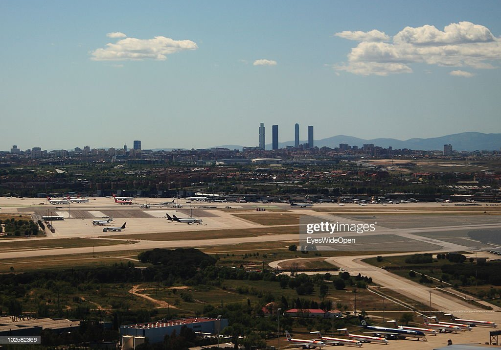 The Barajas International Airport and landscape around the capital city of Madrid on May 25, 2010 in Madrid, Spain. Madrid is a big european city with more than 3 million inhabitants.