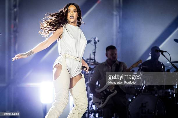 The Barbadian singer Rihanna during the concert Behind her a guitarist and a drummer ANTI World Tour San Siro Stadium Milan 13th July 2016