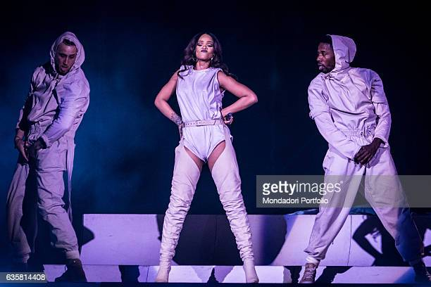 The Barbadian singer Rihanna during the date of the ANTI World Tour hosted in Milan Beside her two male dancers San Siro Stadium Milan 13th July 2016