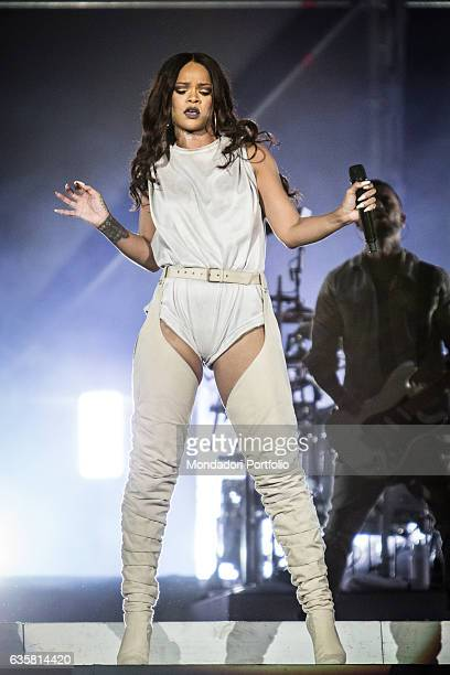 The Barbadian singer Rihanna during the date of the ANTI World Tour hosted in Milan Behind her a guitarist San Siro Stadium Milan 13th July 2016