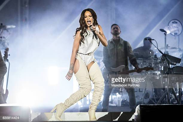 The Barbadian singer Rihanna during the date of the ANTI World Tour hosted in Milan Behind her a guitarist and a drummer San Siro Stadium Milan 13th...