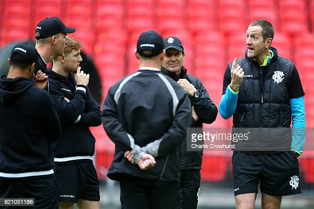 The Barbarians assistant coach Will Greenwood chats to the players during the Barbarians Captain's Run at Wembley Stadium on November 4 2016 in...