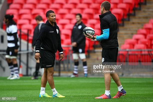 The Barbarians assistant coach Will Greenwood chats with Clayton Blommetjies during the Barbarians Captain's Run at Wembley Stadium on November 4...