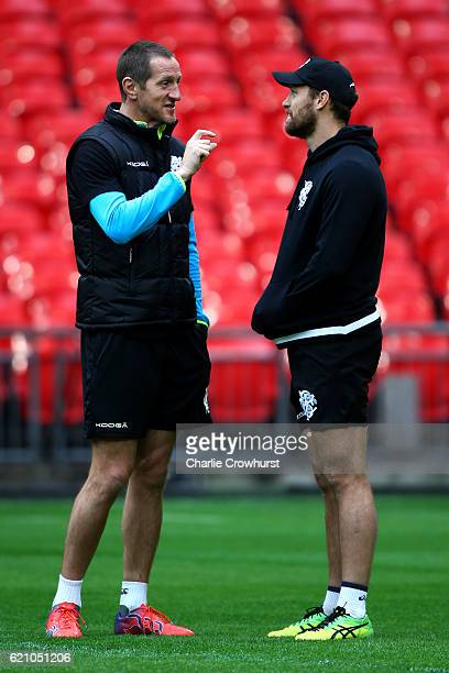 The Barbarians assistant coach Will Greenwood chats with Luke Morahan during the Barbarians Captain's Run at Wembley Stadium on November 4 2016 in...