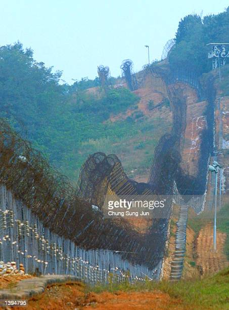 The barbed wire fences along the minestrewn Demilitarized Zone between the two Koreas is shown September 19 2002 in Paju north of Seoul South Korea...