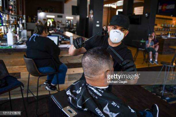 The BarBerShop owner Jose Oregel gives Jorge Orellana a haircut on April 28 2020 in Greeley Colorado Colorado's monthlong stayathome order expired on...