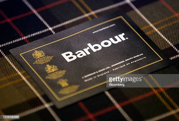 The Barbour logo sits inside a jacket during production at J Barbour Sons Ltd in South Shields UK on Tuesday Nov 6 2012 While the UK emerged from...