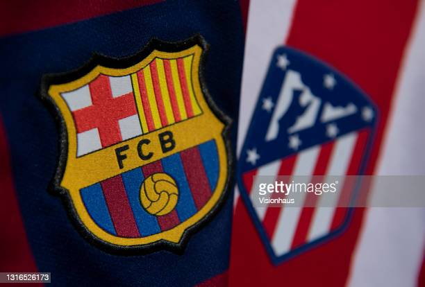 The Barcelona and Atletico Madrid club badges on their first team home shirts on May 5, 2021 in Manchester, United Kingdom.