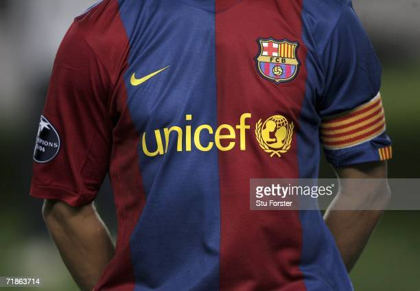 The Barcelona captain Carles Puyol in the team line up before the game with their new 'UNICEF' shirt during the UEFA Champions League Group A match...