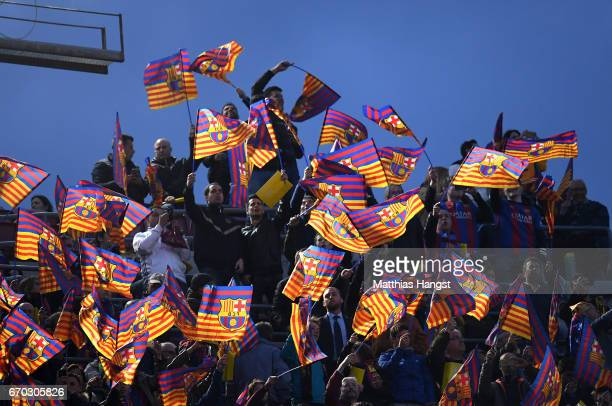 The Barcelona fans wave flags during the UEFA Champions League Quarter Final second leg match between FC Barcelona and Juventus at Camp Nou on April...