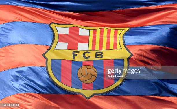 The Barcelona logo is seen on a flag waving above the stadium prior to the UEFA Champions League Quarter Final Leg One match between FC Barcelona and...