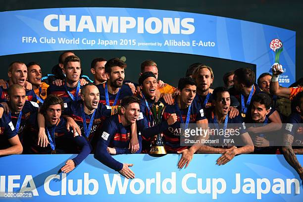 The Barcelona players celebrate with the trophy following their team's 30 victory during the FIFA Club World Cup Final between River Plate and FC...