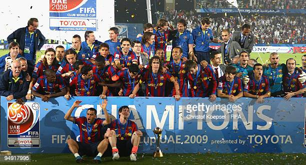 the Barcelona squad celebrates with the cup after winning 21 after extra time the FIFA Club World Cup Final match between Estudiantes LP and FC...