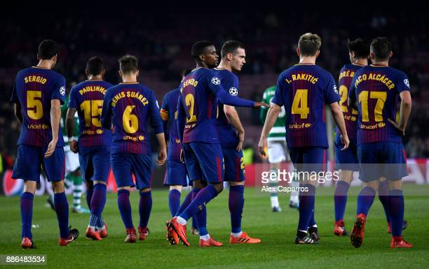 The Barcelona team celebrate after Jeremy Mathieu of Sporting Lisbon scored a own goal for Barcelona's second goal during the UEFA Champions League...