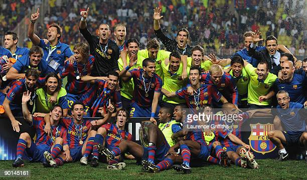 The Barcelona team celebrate after victory in the UEFA Super Cup Final between FC Barcelona and Shakhtar Donetsk at The Stade Louis II Stadium on...