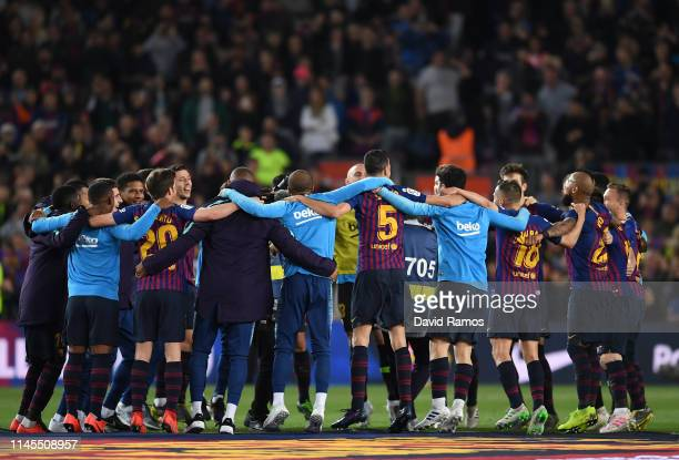 The Barcelona team celebrate as they win the La Liga following their victory in the La Liga match between FC Barcelona and Levante UD at Camp Nou on...