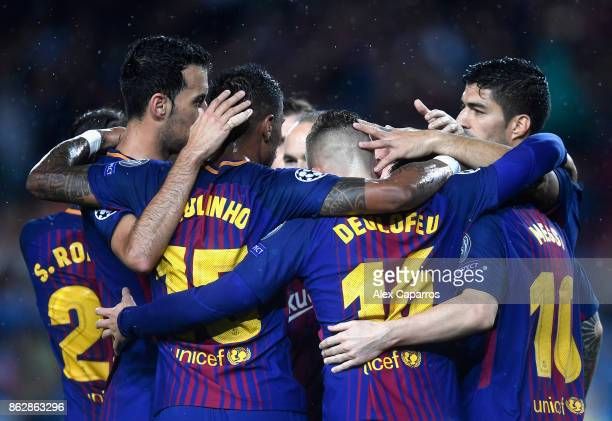 The Barcelona team celebrate their sides first goal during the UEFA Champions League group D match between FC Barcelona and Olympiakos Piraeus at...