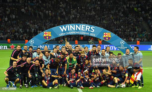The Barcelona team celebrate victory after the UEFA Champions League Final between Juventus and FC Barcelona at Olympiastadion on June 6 2015 in...