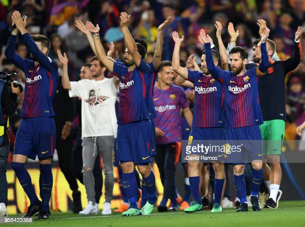 The Barcelona team celebrate winning the league after the La Liga match between Barcelona and Real Madrid at Camp Nou on May 6 2018 in Barcelona Spain