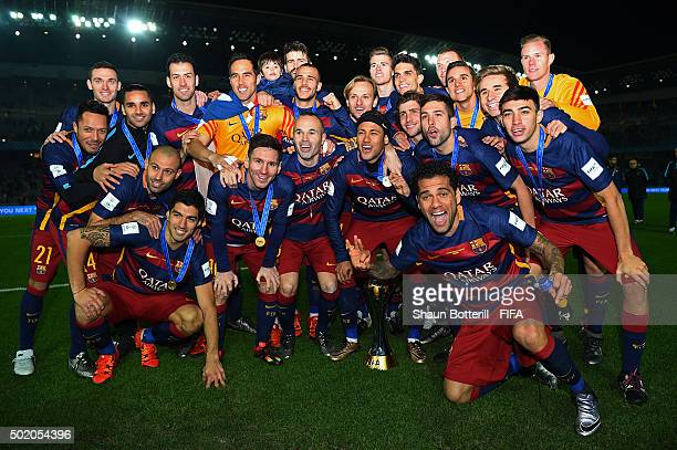 The Barcelona team celebrate with the trophy following their team's 30 victory during the FIFA Club World Cup Final between River Plate and FC...