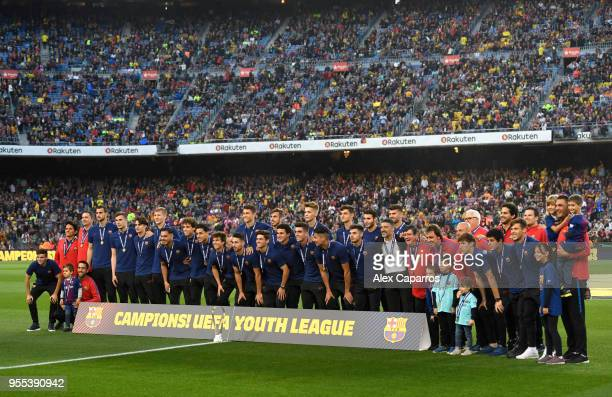 The Barcelona youth team pose for a photo prior to the La Liga match between Barcelona and Real Madrid at Camp Nou on May 6 2018 in Barcelona Spain