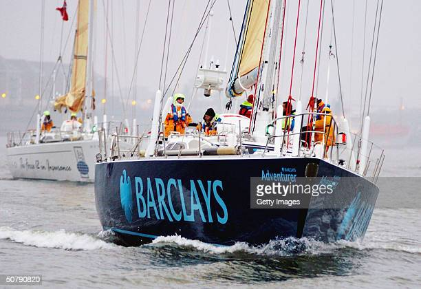 The Barclays Adventurer crew and the rest of the group of twelve boats that will compete in the Global Challenge Round the World Yacht Race go past...