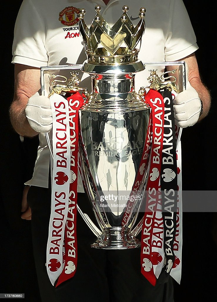 The Barclays Premier League trophy is carried during the official Manchester United official lunch at Westin Hotel on July 18, 2013 in Sydney, Australia.