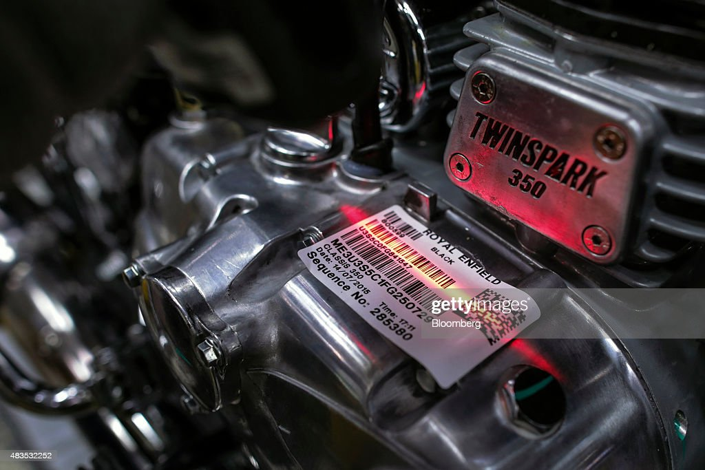 The barcode on a Royal Enfield Motors Ltd Thunderbird Twinspark engine attached to a Classic 350 motorcycle is scanned on the production line at the..