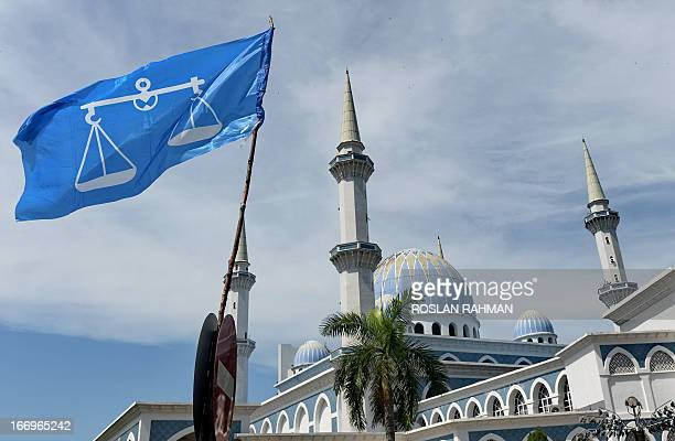 The Barisan National party flag flies next to the Sultan Ahmad Shah State Mosque in Kuantan on April 19 the hometown of Malaysia's Prime Minister...