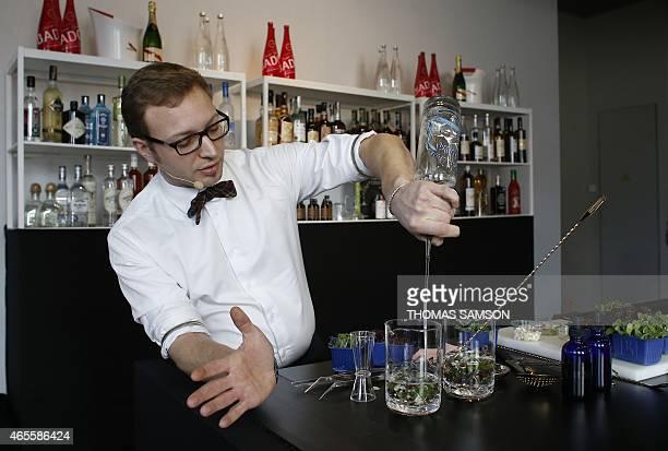 The barman from the Apicius restaurant Valentin Calvel mixes a cocktail on March 8 2015 during the Paris Omnivore fair AFP PHOTO / THOMAS SAMSON