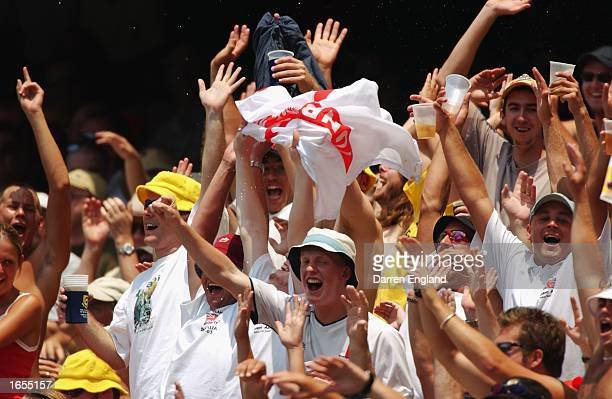 The Barmy Army celebrate an Australian wicket during day one of the First Ashes Test played between Australia and England held at the Gabba in...