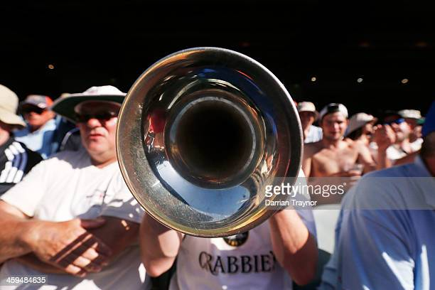 The Barmy Army trumpeter plays during day two of the Fourth Ashes Test Match between Australia and England at Melbourne Cricket Ground on December 27...