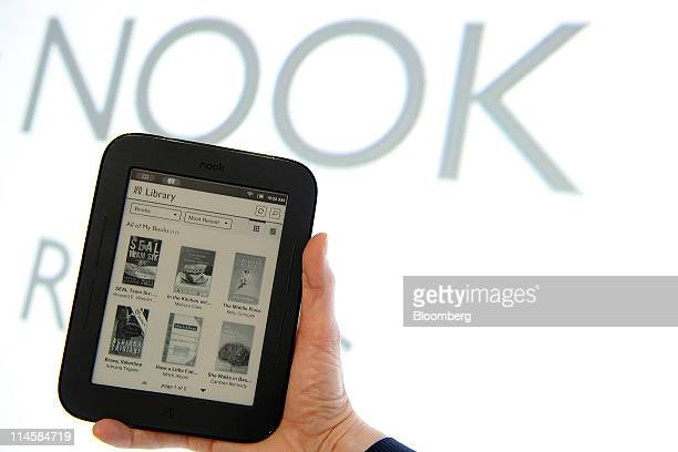 The Barnes Noble Inc Nook electronic reader is displayed for a photograph during an event in New York US on Tuesday May 24 2011 Barnes Noble Inc the...