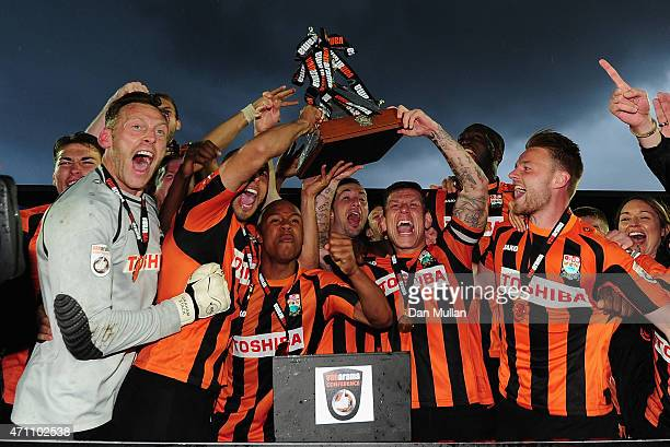 The Barnet Team celebrate with the trophy after clinching promotion during the Vanarama Football Conference League match between Barnet and Gateshead...
