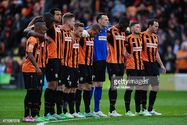 The Barnet team observe a minutes silence in memory of the Bradford Fire during the Vanarama Football Conference League match between Barnet and...