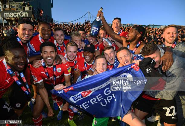 The Barnsley side celebrate after promotion to the Championship during the Sky Bet League One match between Bristol Rovers and Barnsley at Memorial...