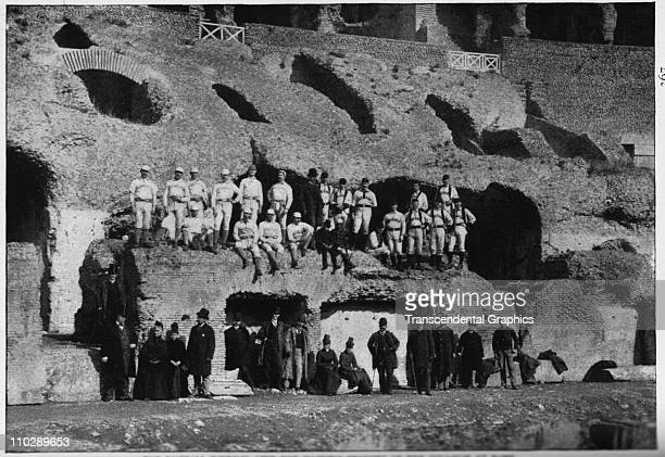 The barnstorming baseball tourists from the Chicago White Stockings club and chosen All Stars pose in the Coliseum on March 1 1889 in Rome Italy