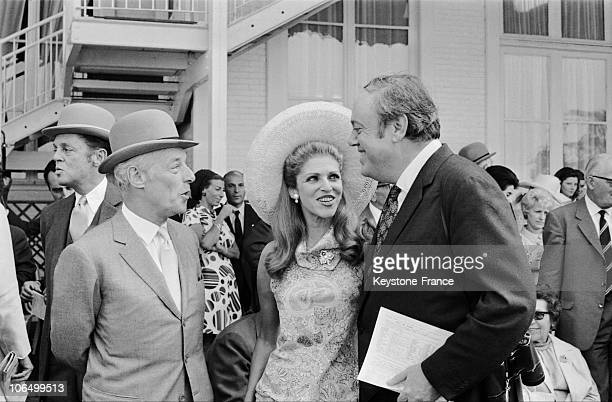 The Baron Guy De Rothschild And His Wife MarieHelene Speaking With Great Britain'S Ambassador To Paris Christopher Soames During The Prix De Diane At...