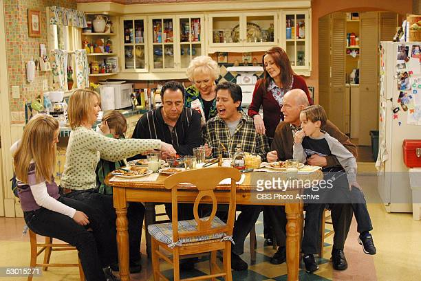 The Barone family enjoys Marie's home cooking on the May 16 series finale of EVERYBODY LOVES RAYMOND From left to right Madlyin Sweeten Monica Horan...