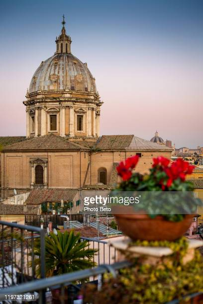 a warm sunset light illuminates the rooftops of rome and the church of sant'andrea - tosca opera stock pictures, royalty-free photos & images